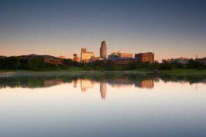 nebraska skyline reflected on downtown lake