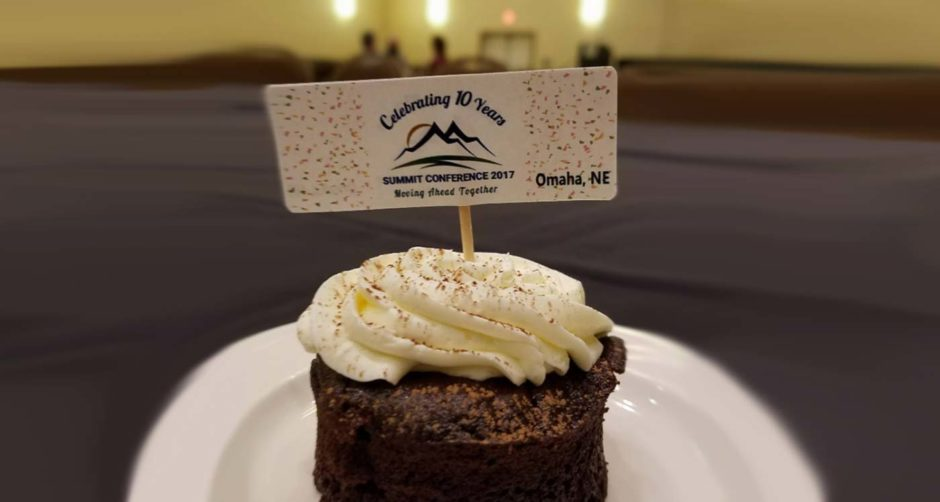 cupcake on plate displaying moving ahead together summit conference 2017 placeholder