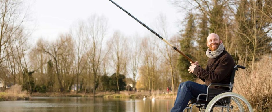 man on wheelchair spending quality time in fishing day