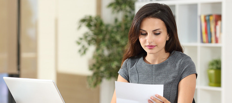 Young woman reading a report